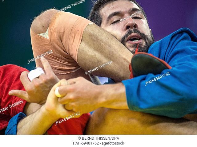 Muhammet Yahya Karatas (R) of Turkey competes in the Sambo - Men's -74kg 1/8 Final with Jordan Amoros of France at the Baku 2015 European Games in Heydar Aliyev...