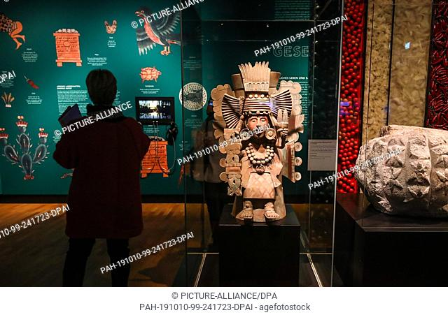 """10 October 2019, Baden-Wuerttemberg, Stuttgart: A woman looks at the """"""""Aztec"""""""" exhibition in the Linden Museum. The Great Aztec National Exhibition will take..."""