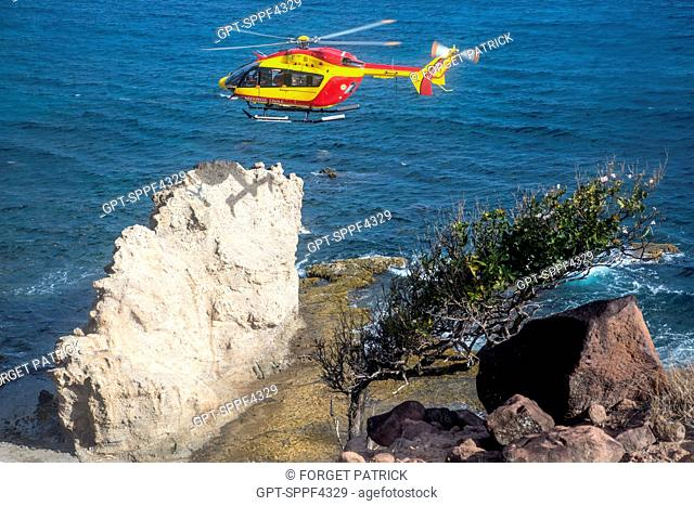 RECONNAISSANCE MISSION TO LOOK FOR PEOPLE WHO DISAPPEARED AROUND THE PETIT ANSE OF THE ANSES D'ARLET, HELICOPTER RESCUE WITH THE CIVIL SECURITY'S DRAGON 972...