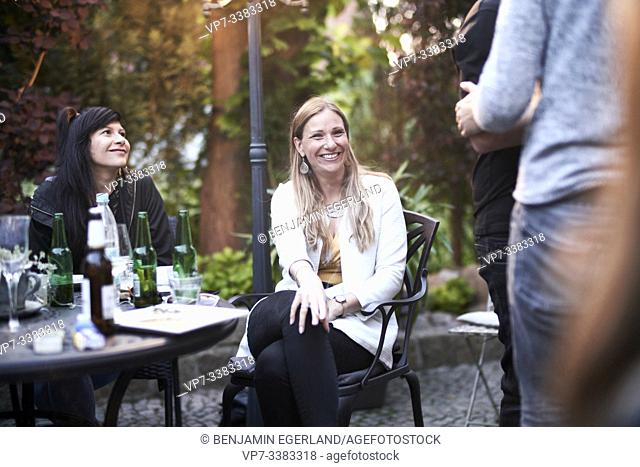 middle-aged woman at gathering with friends, garden party
