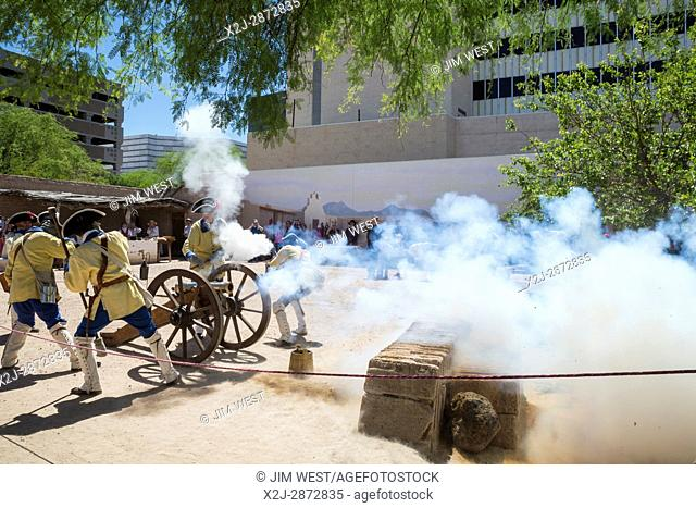 Tucson, Arizona - Soldiers demonstrate firing a cannon during Living History Day at the Tucson Presidio. The original Spanish fortress was built in 1775