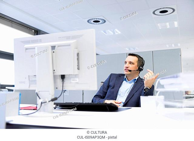 Businessman taking a video call using computer in office