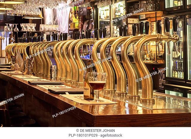Bar counter showing array of Belgian draught beers served by taps in the Flemish café Rock Circus in the city Ghent, East Flanders, Belgium