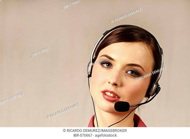 Young woman with a headset, call center, telephonist