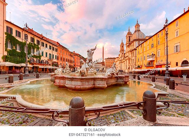 The Fountain of Neptune on the famous Piazza Navona Square at sunrise, Rome, Italy