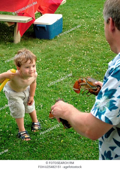Montpelier, VT, Vermont, father showing young son a live lobster