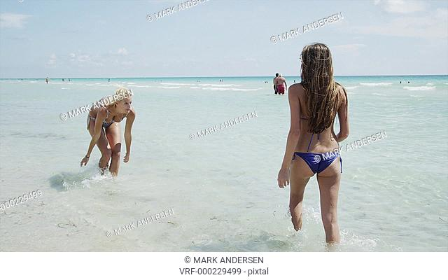 WS Two women playing in surf / South Beach, Miami, Florida, USA