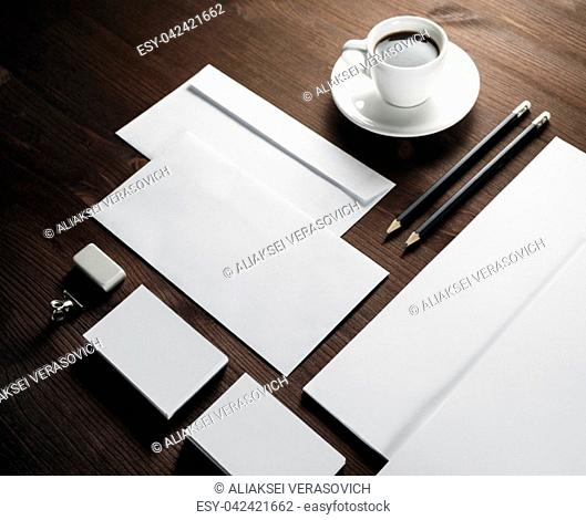 Mockup for branding identity. Blank corporate stationery set on wood table background