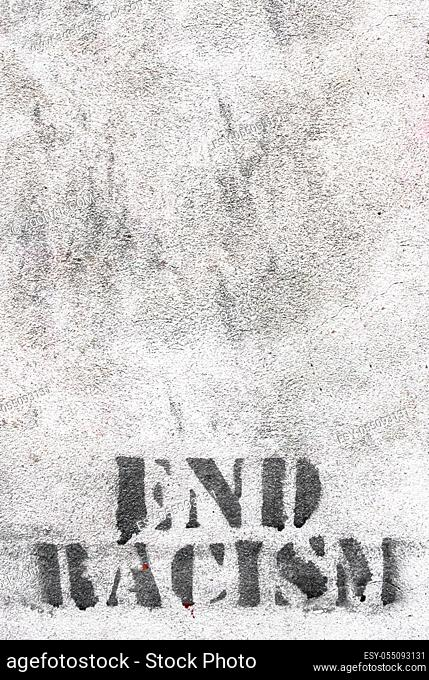 Graffiti on brick wall say - END RACISM. Ideal for concepts and backgrounds