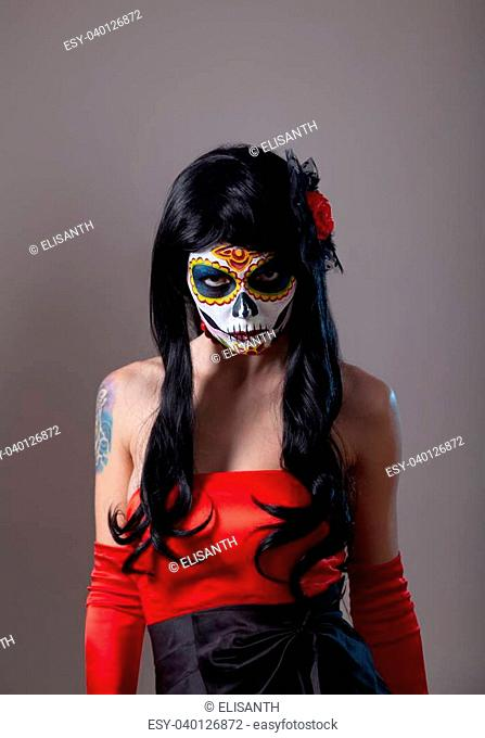 Sugar skull girl with red rose, Mexican Day of the Dead or Halloween