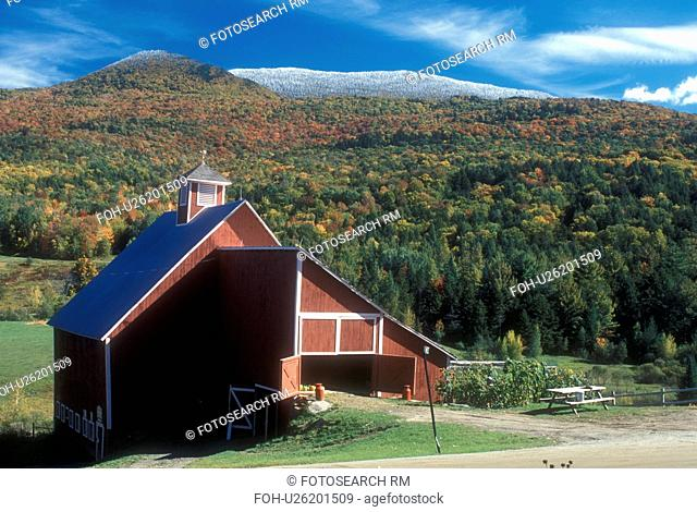 barn, fall, snow, Stowe, VT, Vermont, Scenic view of a red barn on a farm with a dusting of snow on the mountains surrounded by colorful fall foliage in autumn