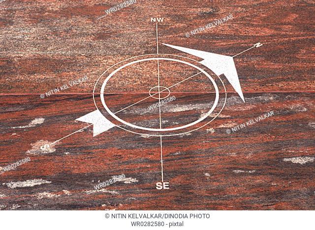 Design of compass engraved on flooring showing direction at Swami Vivekananda Rock Memorial Mandapam , Kanyakumari , Tamil Nadu , India