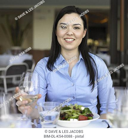 Young woman at restaurant table, Perth, Australia