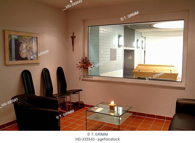 Cremation in Hamburg crematorium on the cemetery Hamburg Oejendorf. The picture shows a farewell room for relativs with a view to the coffin in front of the...
