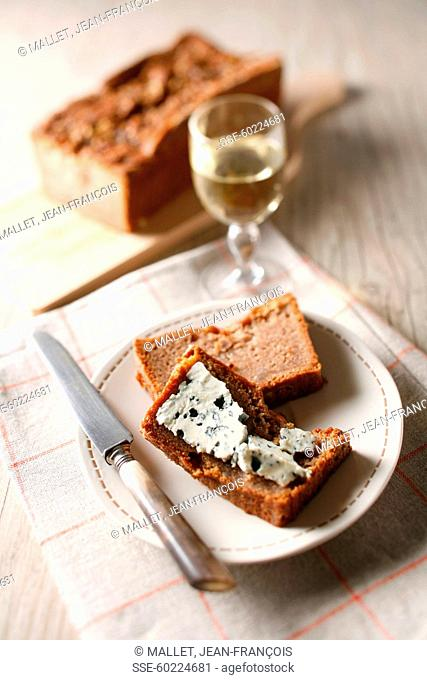 Spicy and Roquefort terrine ,bottle and glass of white wine