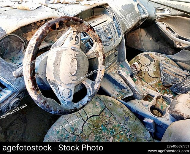 Dirty transport motorized vehicle damaged car interior after flood or heavy rain
