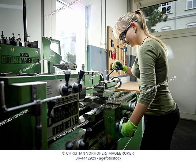 Young woman working on lathe, Metalwork, training