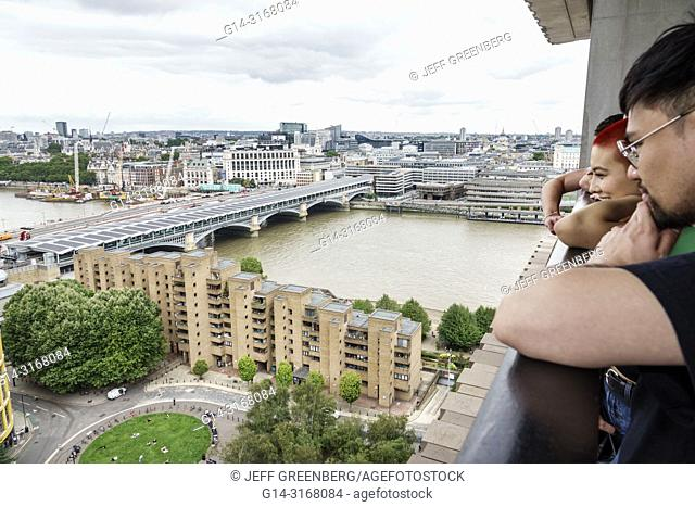 United Kingdom Great Britain England, London, Bankside, River Thames, Tate Modern art museum terrace view, city skyline, gray sky, Asian, man, looking