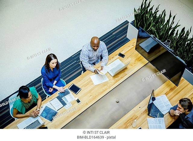 High angle view of business people working in office meeting