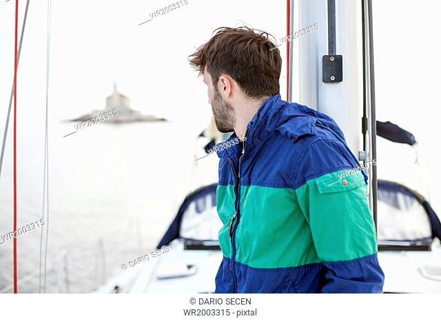Man overlooking sea from sailboat, Adriatic Sea