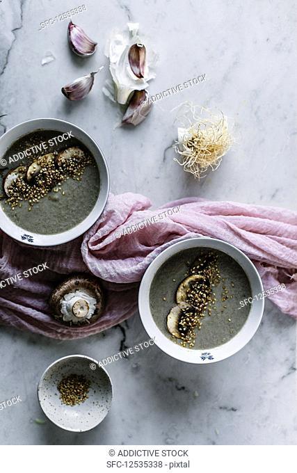 Tasty mushroom cream soup served in bowl on table
