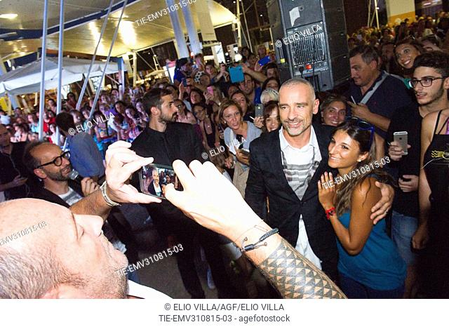 Eros Ramazzotti does a photo with fans at Milan Expo 2015, Milan, ITALY-28-08-2015