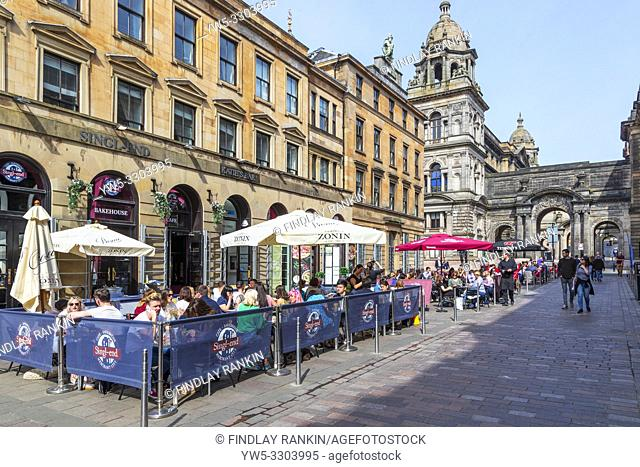 Customers eating outdoors at restaurants and cafes in Glasgow's Italian centre, John Street, Glasgow, Scotland, UK