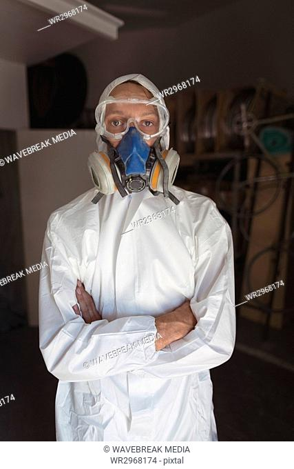 Portrait of employee wearing gas mask at workshop