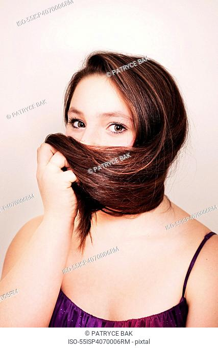 Teenage girl hiding her face with hair
