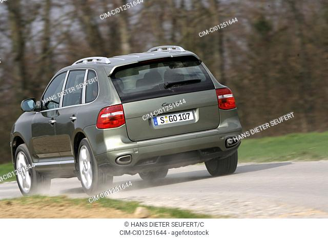 Porsche Cayenne, model year 2005-, silver, driving, diagonal from the back, rear view, country road