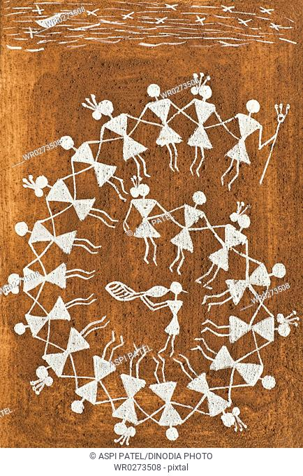 Warli art from way of passing their common folklore , Thane , Maharashtra , India