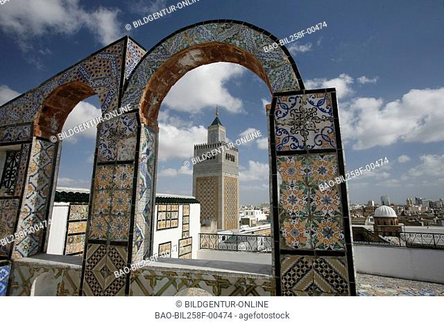 The minaret of the MoscheeZaytouna or big mosque in the Old Town or Medina of the capital of Tunis in the Norder of Tunisia in North Africa at the Mediterranean...