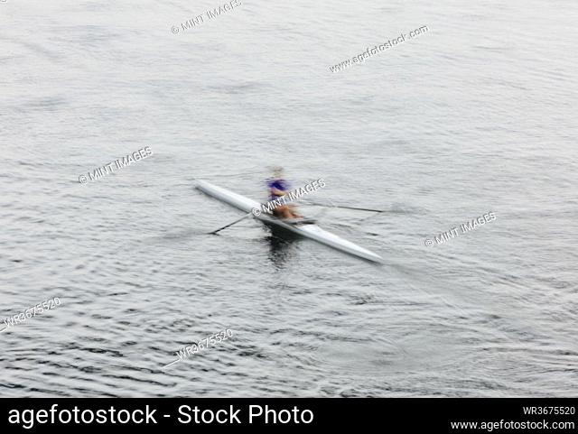 A single scull boat and rower on the water, view from above