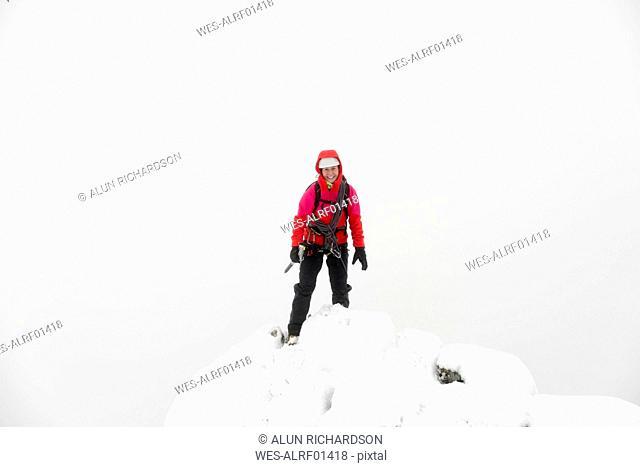 UK, Scotland, Glen Spean, woman on peak of Beinn a Caorainn in winter