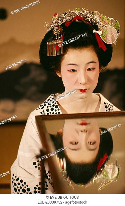 Portrait of a Geisha girl with reflection in a mirror