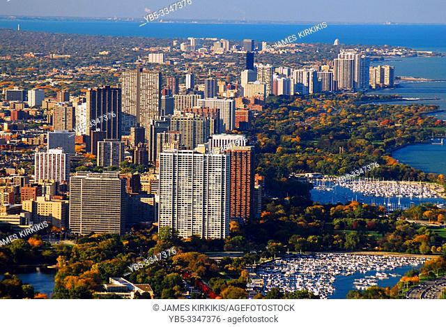 An aerial view of apartment buildings and Lincoln Park in Chicago