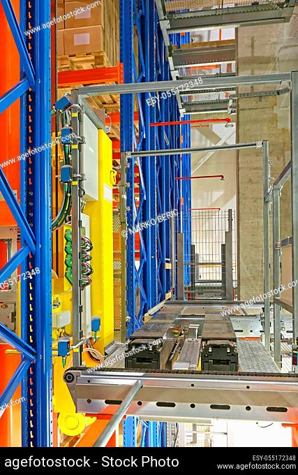Automated Storage and Retrieval System Shuttle Robotic Forks in Warehouse