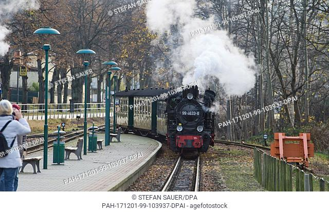 The 99 4633-6 steam engine from the Saxon railway construction and operating company Pressnitztalbahn mbH arrives at Biny station, Germany, 01 December 2017