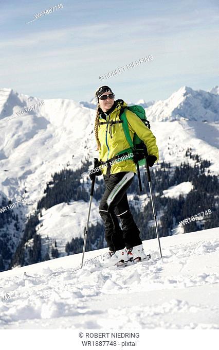 Female backcountry skier, mountain range in background, Alpbachtal, Tyrol, Austria, Europe