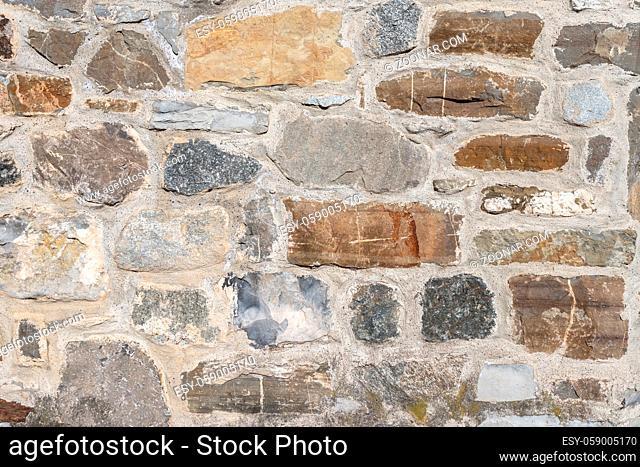 Old ancient brick wall, old texture of stone blocks closeup