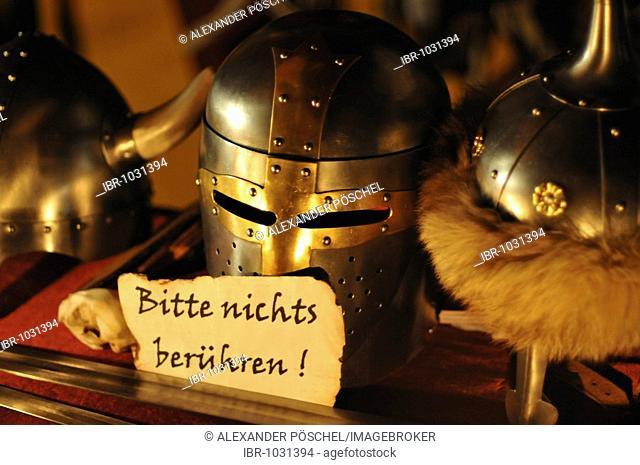 Helmet, sign reading please do not touch, night shot, mediaeval Christmas market, Arsenal, Vienna, Austria