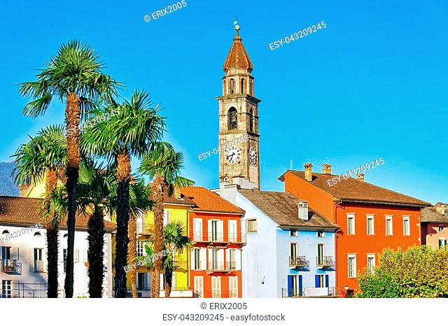 St Peter and Paul church tower and old colorful buildings at the luxurious resort in Ascona on Lake Maggiore, Ticino canton, in Switzerland