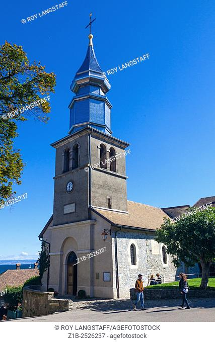 The church of Yvoire with its polished metal spire, Haute Savoie, France