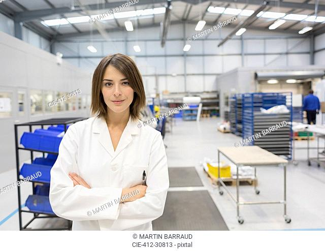 Portrait confident female engineer in steel factory
