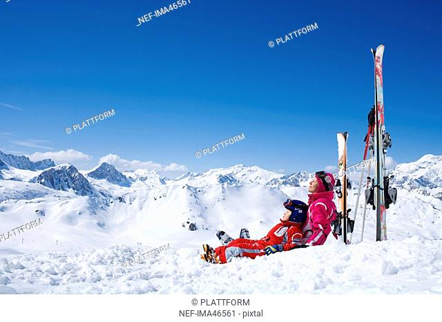 A mother and her sun resting on the slopes
