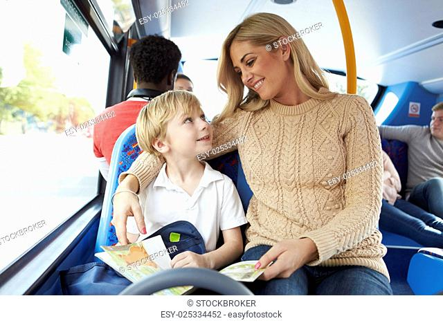 Mother And Son Going To School On Bus Together