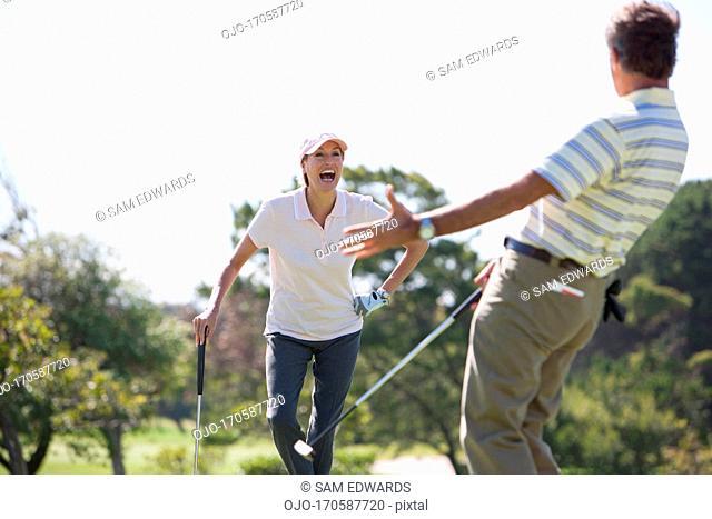 Mature couple enjoying golf
