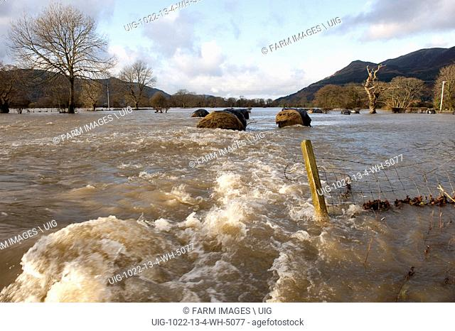 Flooded agricultural land showing big bales and damaged fences. (Photo by: Wayne Hutchinson/Farm Images/UIG)