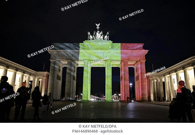 The Brandenburg Gate is illuminated in Belgian national colours, in Berlin, Germany, 22 March 2016. PHOTO: KAY NIETFELD/DPA | usage worldwide