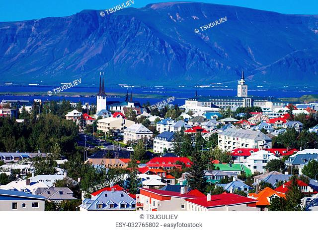 Beautiful super wide-angle aerial view of Reykjavik, Iceland with harbor and skyline mountains and scenery beyond the city